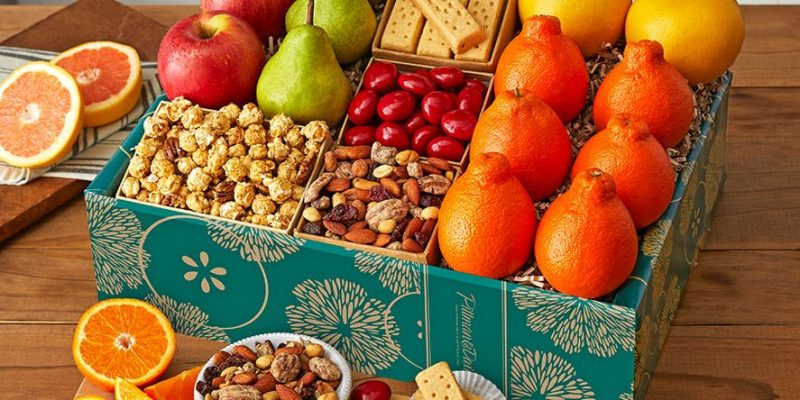 Pittman and Davis | Honeybells & Treats Deluxe | Celebrate sunshine and farm-fresh flavors with this bountiful gift box full of our finest citrus and tree-ripened fruit