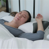 Brookstone | Carbon SnoreX 8 In 1 Cooling Pillow | s the world?s first 8 in 1 technology pillow with Carbon Bamboo AirTech Memory Foam, Graphene and Copper to protect against allergens and bacteria, Dual Arm Rests for the ultimate comfort, plus an Ice CoolCover so you won?t overheat and always stay cool.